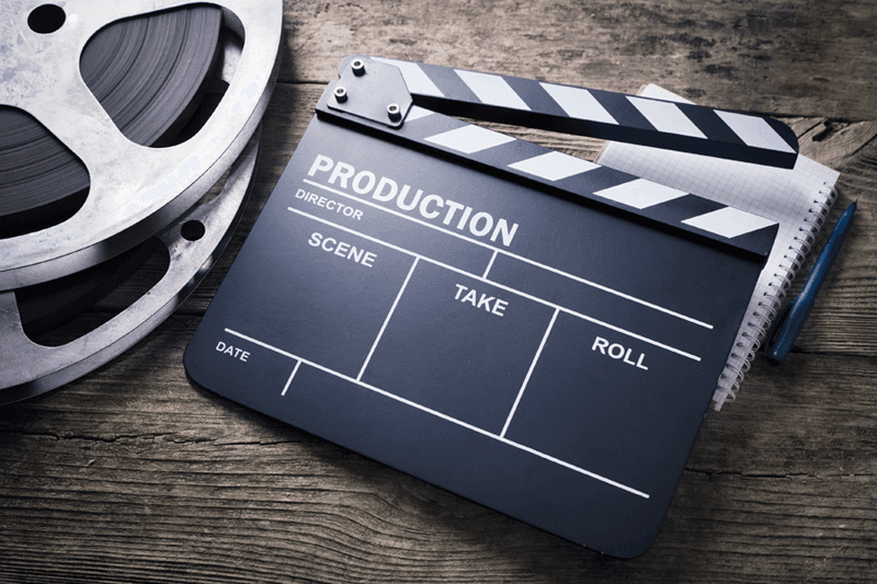 Movie slate and reel