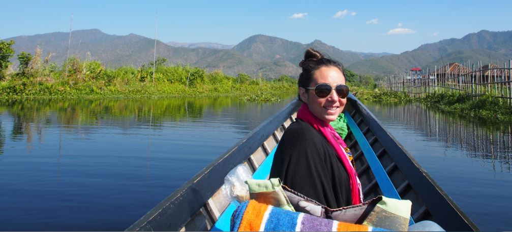 Deirdre is pictured on a boat in Imle Lake, navigating between the houses on stilts.