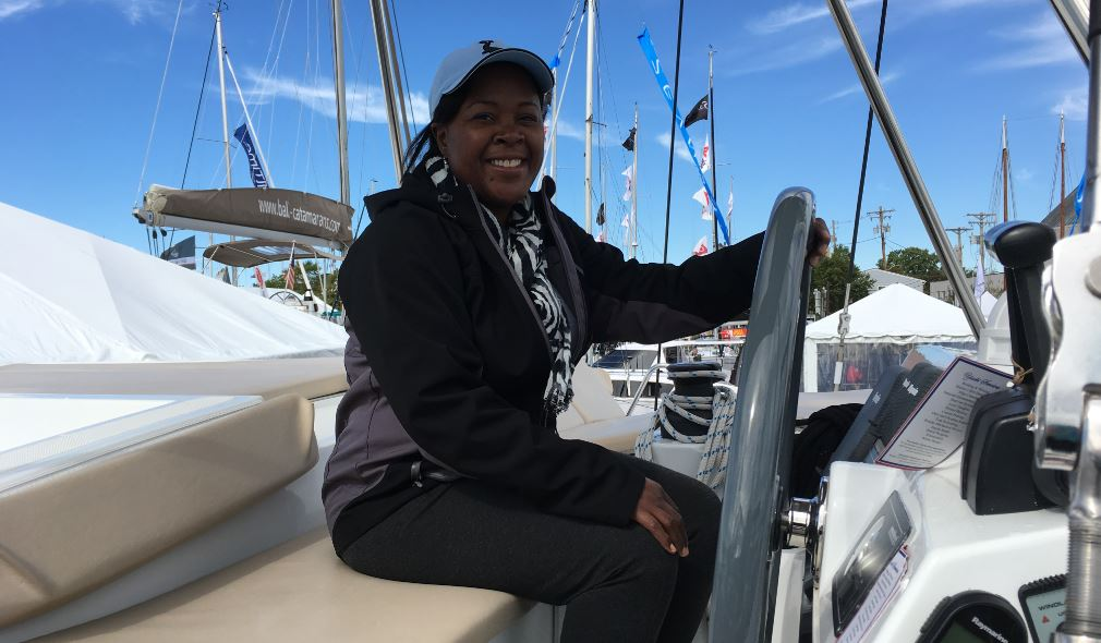 Eldora is pictured smiling radiantly on a boat.