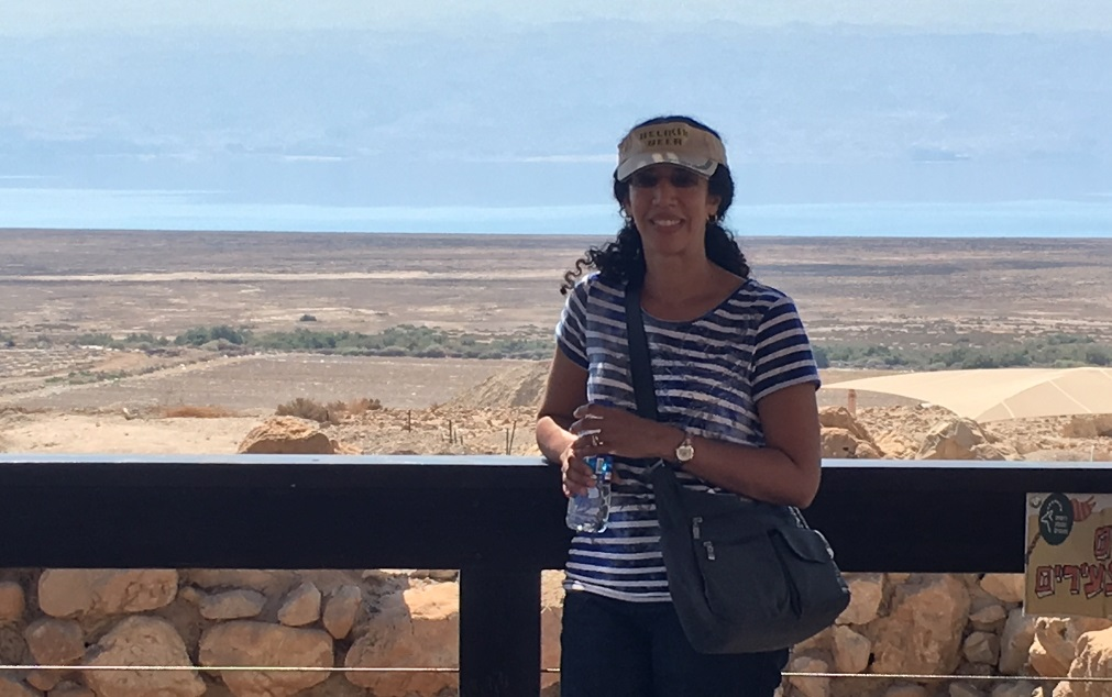 Gaby is pictured standing by the Qumran Caves near the Dead Sea in Israel.