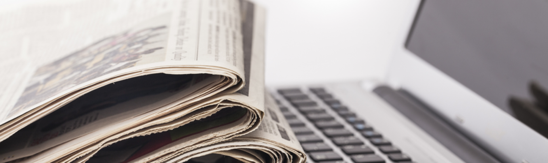 Photo of newspapers on laptop